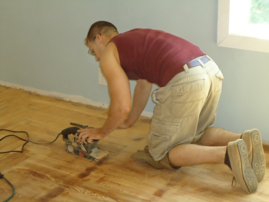 Sanding the floor.  Oh, that floor