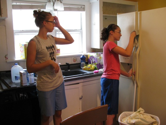 Grace and Glorie helping me clean, and the old frig